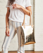 Goldie Everyday Tote in gold metallic by Consuela, model view
