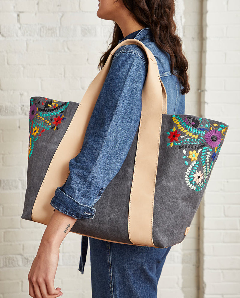 Alexis Large Carryall in grey waxed canvas exterior with colorful floral embroidered accents by Consuela, lifestyle view