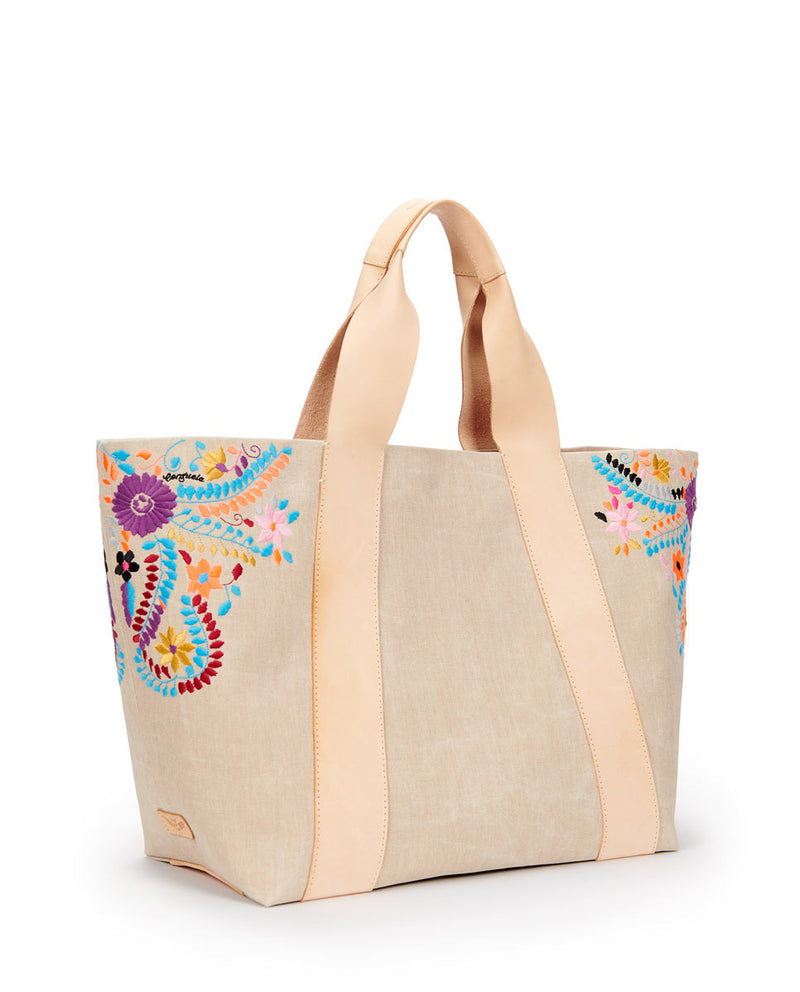 Jocelyn large Carryall Beige waxed canvas exterior with colorful floral embroidered accents by Consuela, side view