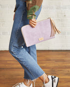Moira L-Shaped Clutch in lilac and charcoal waxed canvas by Consuela, model view