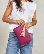 Consuela Raspberry L-Shaped Clutch On Model Back View