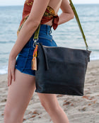 Evie Hobo in black leather by Consuela, lifestyle view