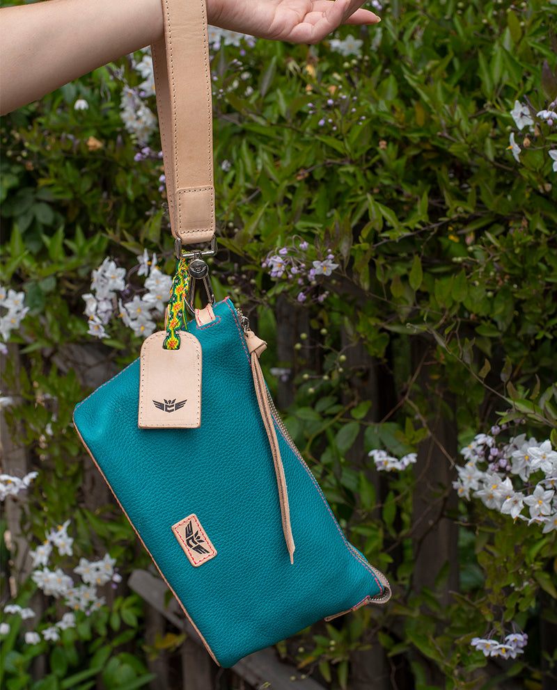 Guadalupe Pouch in turquoise pebbled leather by Consuela, lifestyle view