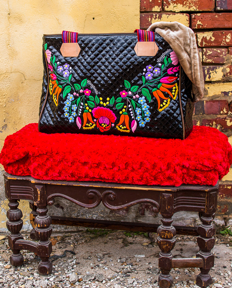 La Reina Grande Tote with Quilted black exterior with our iconic floral embroidery by Consuela, lifestyle image