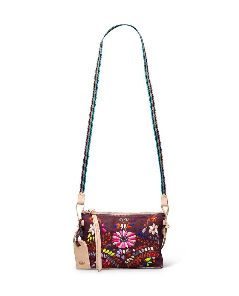 Sonoma Midtown Crossbody in waxed canvas with floral embroidery by Consuela, strap view
