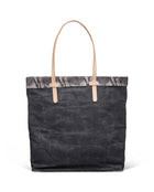 Flynn Slim Tote in grey waxed canvas by Consuela, front view