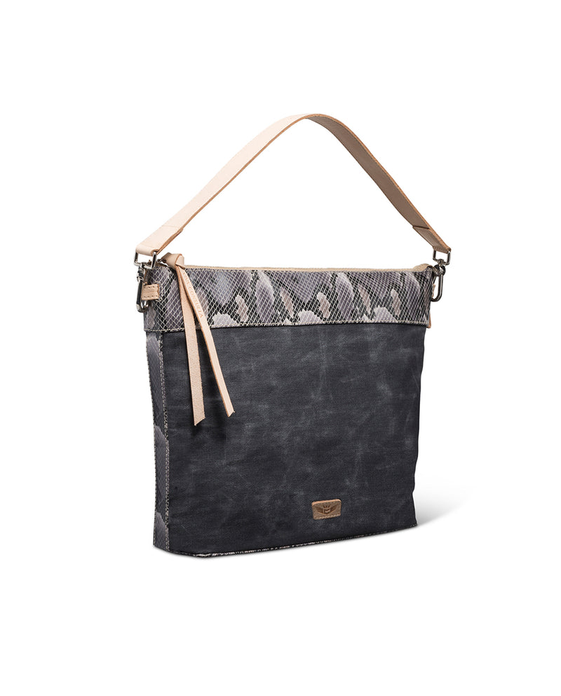 Flynn Hobo in waxed canvas with snake print by Consuela, side view