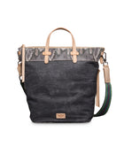 Flynn Sling in waxed canvas with snake print by Consuela, front view