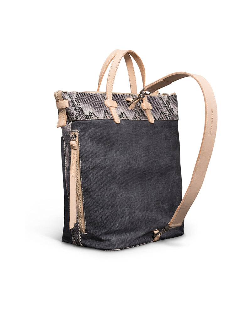 Flynn Sling in waxed canvas with snake print by Consuela, back view