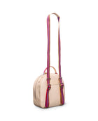 Diego City Pack in natural, untreated leather, by Consuela, side view with a crossbody strap