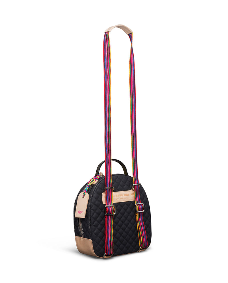 Venice City Pack in black quilted canvas with floral embroidery, by Consuela, side view with crossbody strap