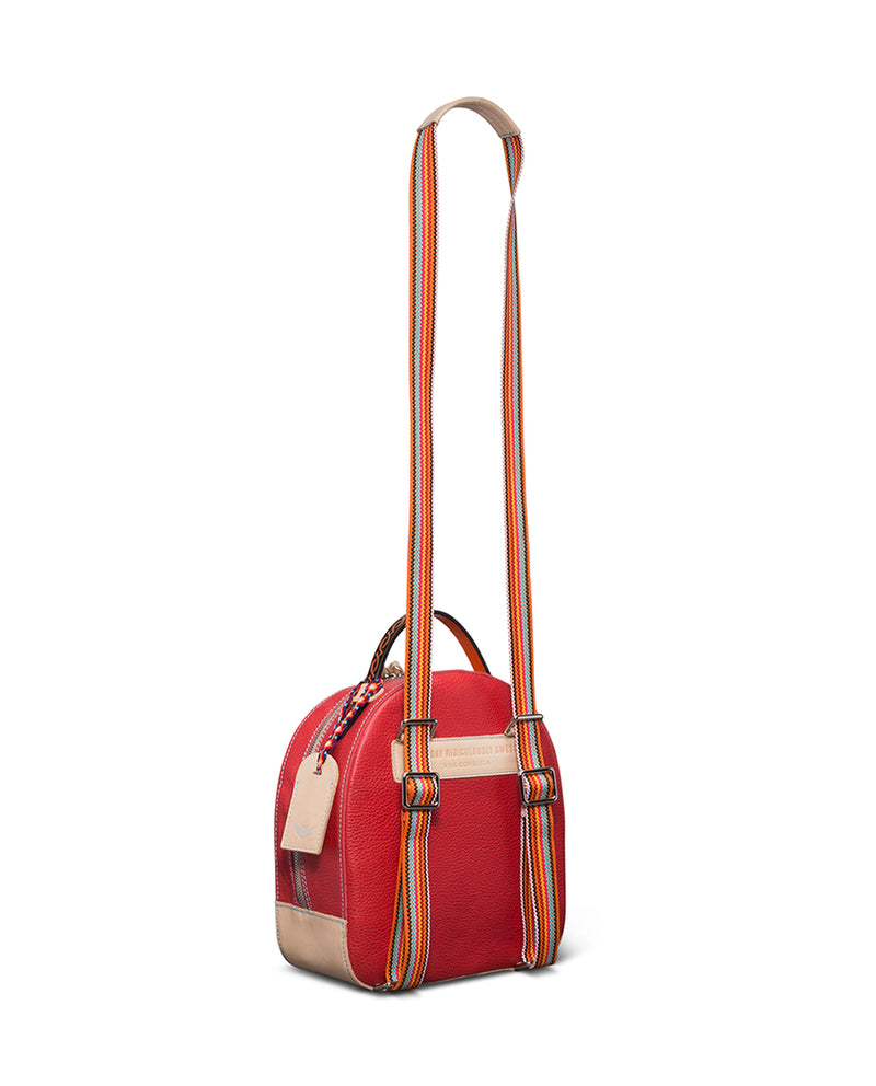 Valentina City Pack in red pebbled leather by Consuela, side view with crossbody strap