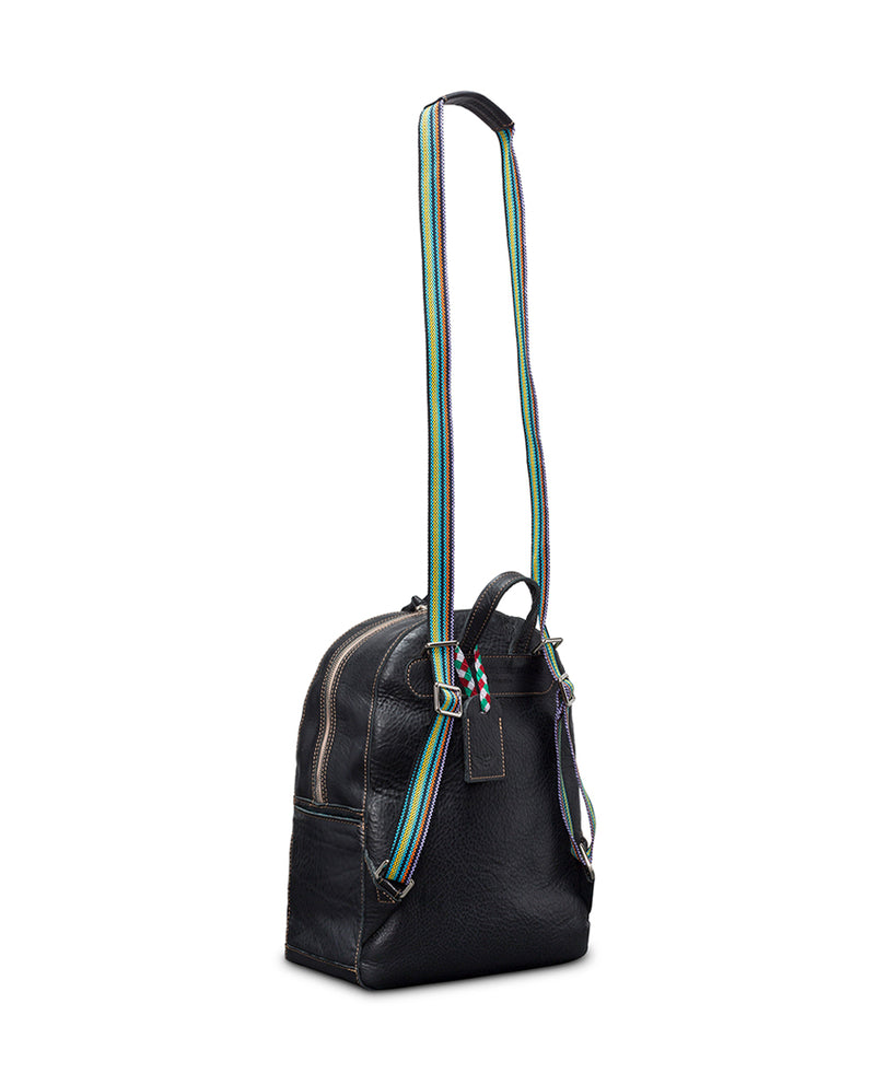 Evie Backpack in black pebbled leather by Consuela, side view