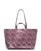 Aurora Jumbo Bag in pink snake print by Consuela, front view