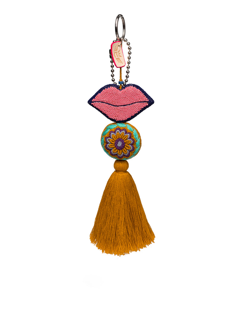 Kyle Charm with beaded lips and tassel by Consuela, front view
