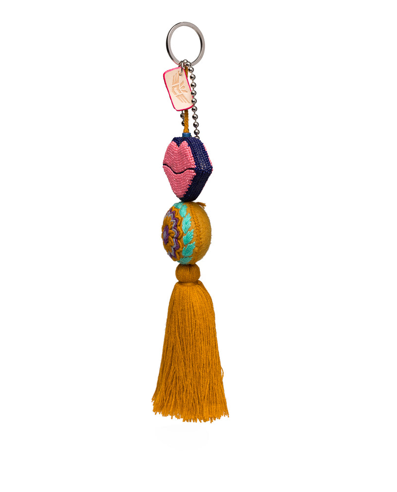 Kyle Charm with beaded lips and tassel, side view