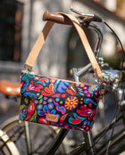 Sophie Your Way Bag in ConsuelaCloth™ by Consuela, lifestyle image on a bike