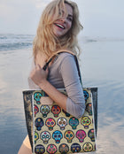 Sugar Skulls Classic Tote in ConsuelaCloth™ by Consuela, lifestyle image girl laughing at the beach