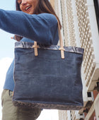 Flynn Slim Tote in grey waxed canvas by Consuela, lifestyle