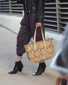 Margot Breezy East West Tote in brown snake print by Consuela, lifestyle image