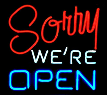 sorry we're open neon sign
