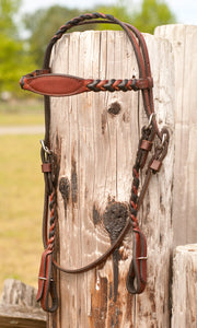 Braided headstall and reins are available in chestnut and black.