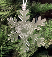 Frosted acrylic snowflake ornament with horse heart engraving.