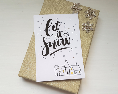 Poppleberry A6 'Let it Snow' Scandinavian - Inspired Folded Christmas Card with Snow & Village Illustration.