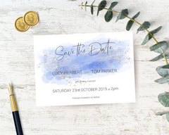 A watercolour blue A6 Poppleberry one-sided wedding save the date card, with gold sparkles.