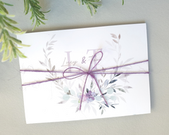Violet & lilac A6 Poppleberry accordion fold all-in-one wedding invitation, folded and wrapped in matching silk thread.