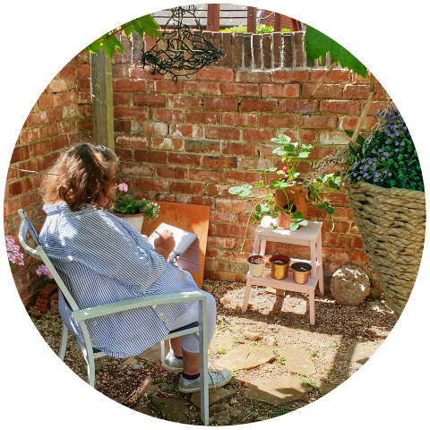 Sunny and Peaceful Garden Scene with Poppleberry Creator, Adele, Peacefully Drawing on her Tablet