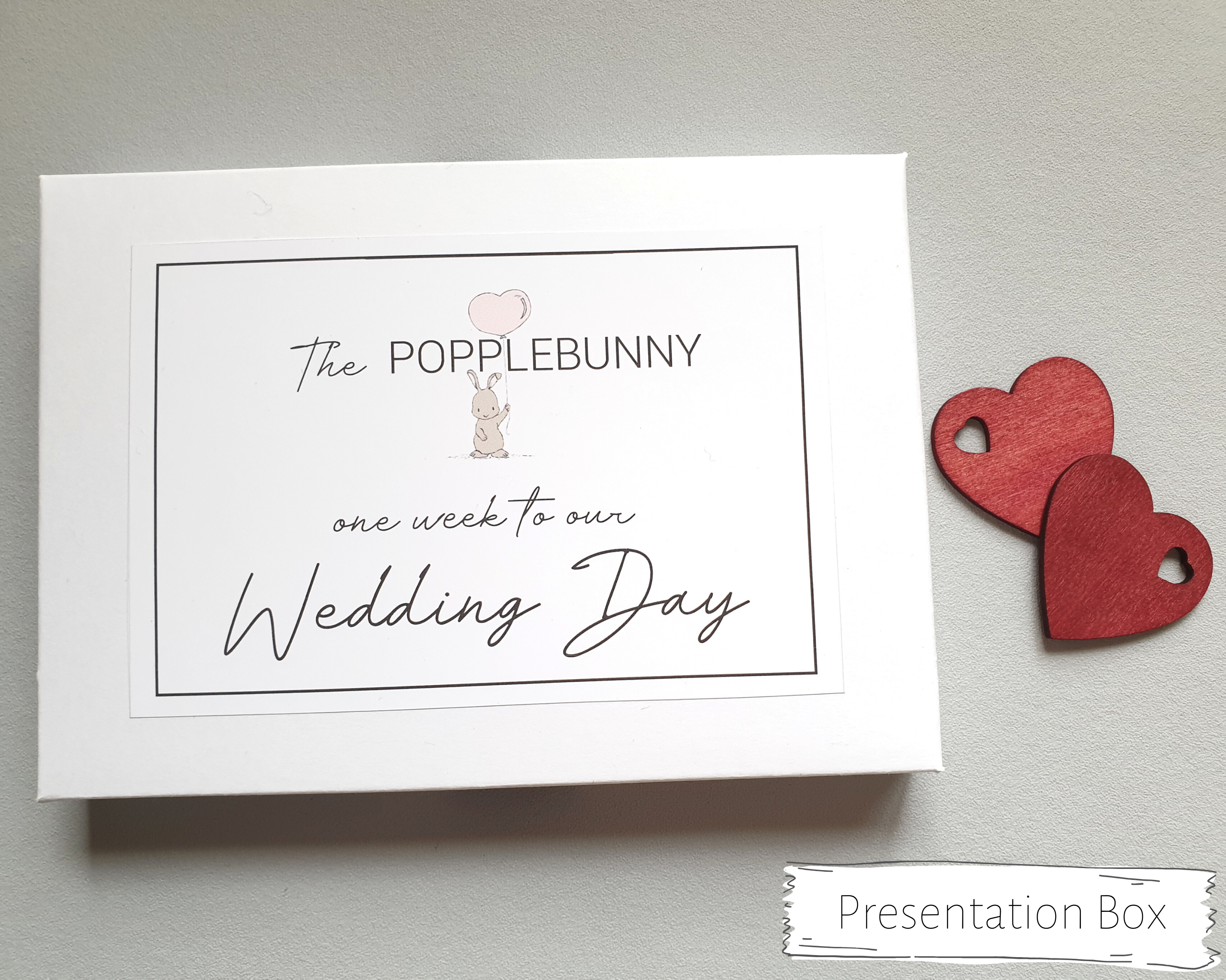 The white presentation box to keep the postcards safe with small bunny (the Popplebunny) illustration.