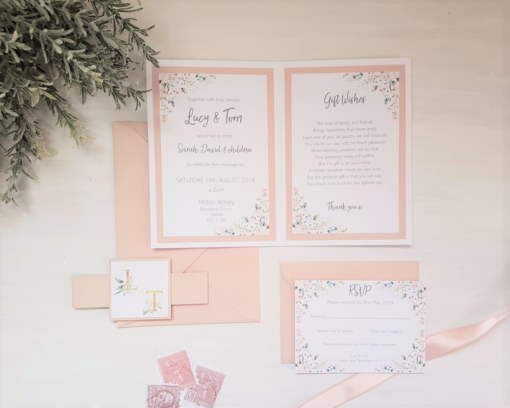 Unfolded blush pink monogram A6 Poppleberry folded wedding invitation set, with RSVP detached with blush pink envelope.