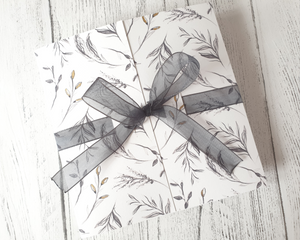 Charcoal wildflower sketch Poppleberry gate-fold wedding invitation set, wrapped with black organza ribbon while folded