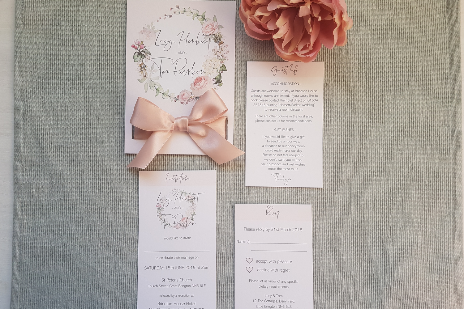 Blush pink bow A6 Poppleberry mini pocket-fold wedding invitation set, with guest info and the RSVP inserts separated.
