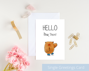 Poppleberry A6 folded greetings card, with a waving brown bear illustration, on white cardstock and white envelope.