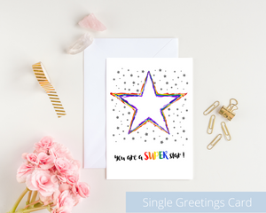 Poppleberry A6 folded greetings card, with a rainbow-coloured star illustration, on white cardstock and white envelope.