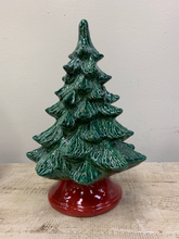 "Load image into Gallery viewer, Hand Painted Medium Christmas Tree stands 12"" high, but on the base it measures 14"" high.  It has a green lustre glaze and red base!  It comes with multi-color pin lights, orange star and a clip-in light kit (7 watt bulb).    Includes free curbside pickup or free shipping."