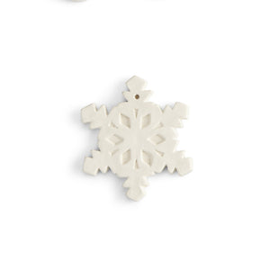This flat snowflake ornament has all the detail you're looking for in a snowflake, with a flat back ideal for adding a personal message, a name, or simply including the year. Our ornaments are also very versatile. They can be used on a gift as a name tag, around a wine bottle for a decorative accent, and the hole at the top make them easy to hang. FUN TIP: Drill a hole in the side of our napkin holder and attach a string to the ornament. Tie the ornament string through the hole in the napkin holder, and you