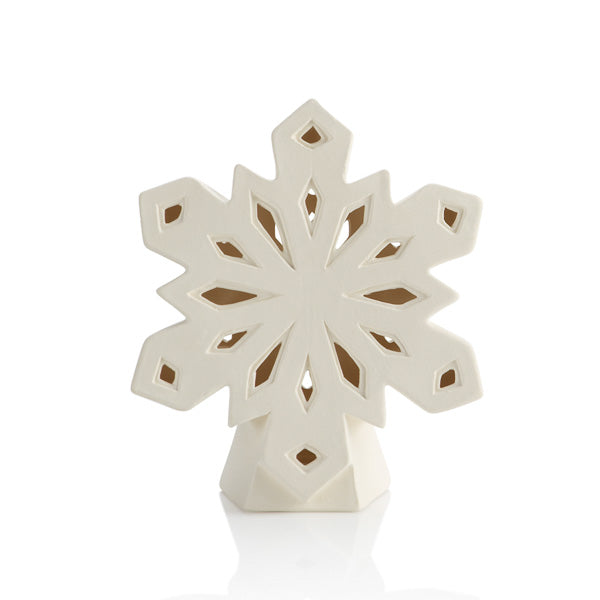 Feature this whimsical snowflake lantern all winter long! Lots of great cut-outs in the front allow for a beautiful glow in very interesting shapes. Add a tea light to set them aglow!