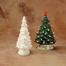 "Load image into Gallery viewer, The 11 1/4"" ceramic Shelf Christmas Tree is sized just right to fit on a shelf, mantle, windowsill, you name it! Its narrow, including the base, so it sits nicely, but from the front still looks like a regular shaped Christmas Tree.  Paint it green, pink, teal, white, or any color you want!   It comes with multi-color pin lights and a clip-in light kit (7 watt bulb)."