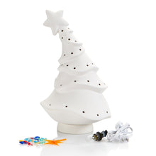 "Load image into Gallery viewer, The Animated Christmas Tree will add a little whimsy to the holiday season. Reminiscent of cartoon trees, it's fun, unique and full of holiday cheer!    This tree stands 13 1/4"" high. It comes with multi-color pin lights and a clip-in light kit (7 watt bulb)."