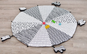 Black and White play mat with toys