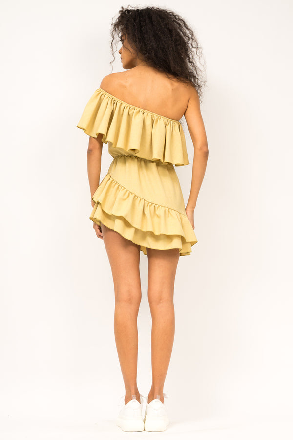 Asymmetrical dress with ruffle on a shoulder