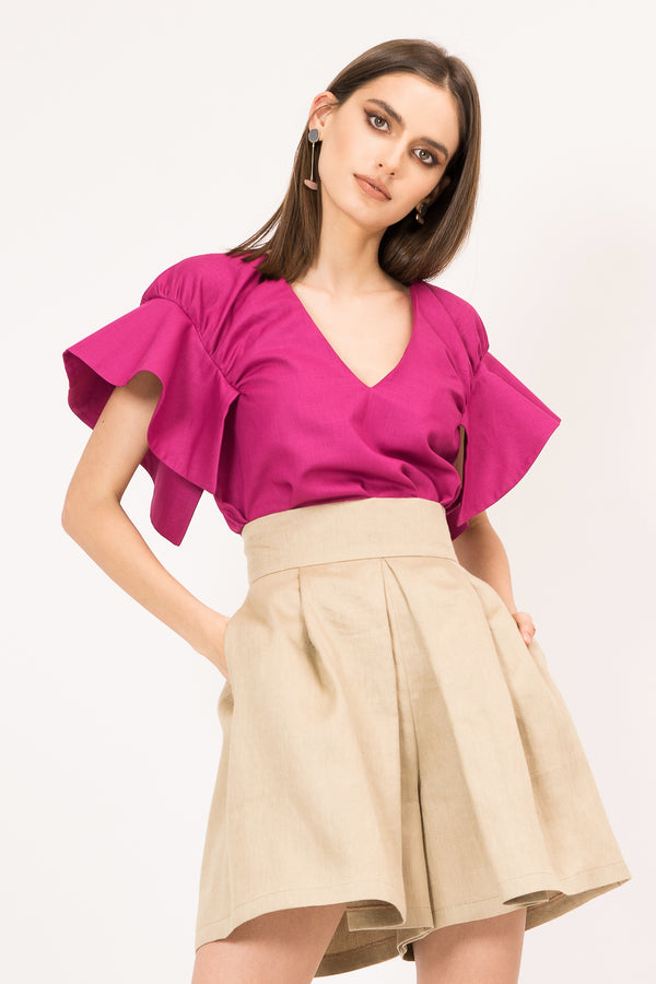 Shirt with ruffles on the shoulders