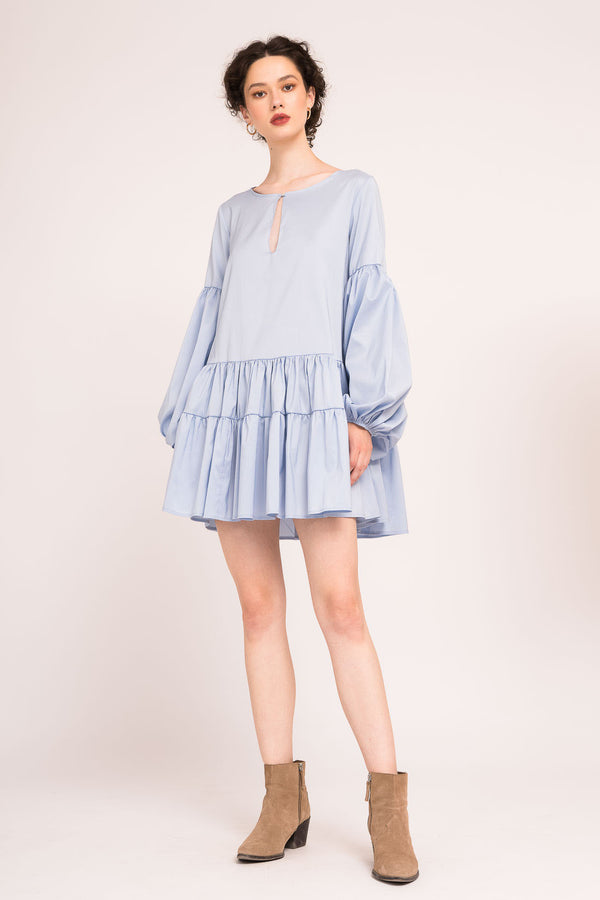 Short dress with flounces and long sleeves