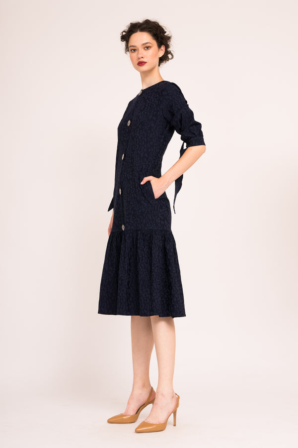 Jacquard dress with oversized buttons and ribbon cuffs