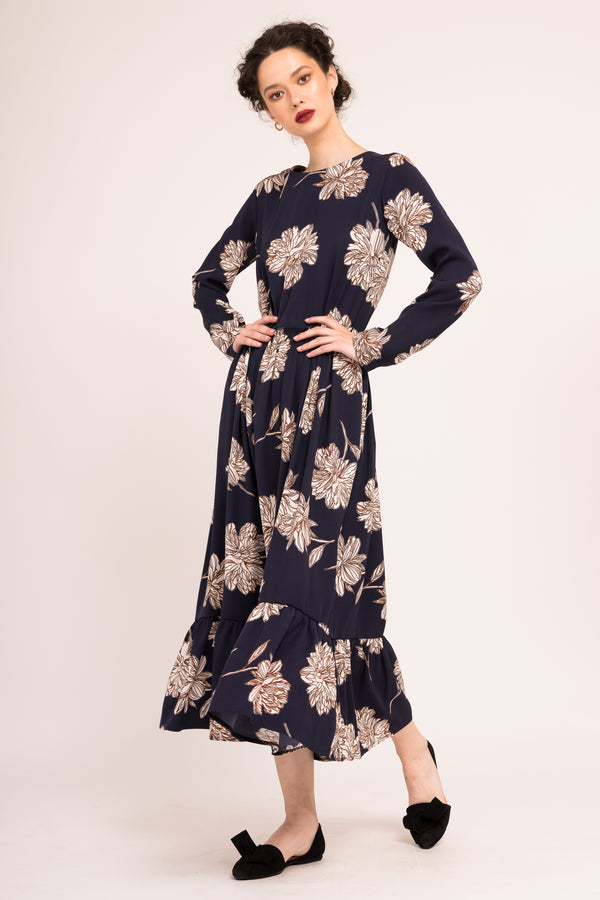 Printed flared dress with long sleeves and pockets