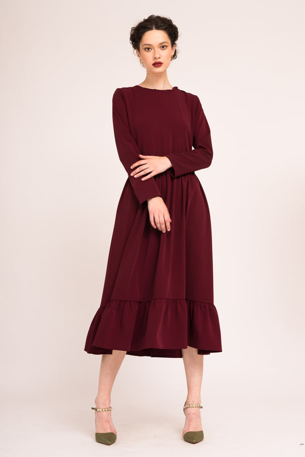 Calf length flared dress with long sleeves