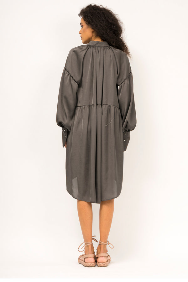 Asymmetrical satin dress with front tie and oversized cuffs
